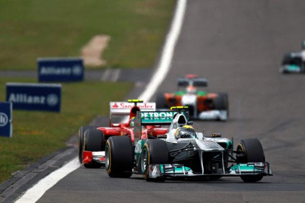 Nurburgring, Germany24th July 2011Nico Rosberg, Mercedes GP W02, 7th position, leads Felipe Massa, Ferrari 150° Italia, 5th position. Action. World Copyright:Glenn Dunbar/LAT Photographicref: Digital Image C27C4435