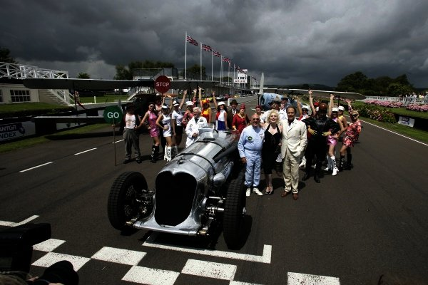 2007 Goodwood Revival Press Day. Goodwood, West Sussex. 18th July 2007. Sir Stirling Moss, Marilyn Monroe and Lord March, with The Essolube Girls, by a Napier Railton and 2 byplanes.World Copyright: Gary Hawkins/LAT Photographic. Ref: Digital Image Only.