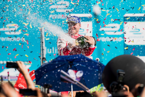 2016/2017 FIA Formula E Championship. Round 7 - Berlin ePrix, Tempelhof Airport, Berlin, Germany. Saturday 10 June 2017. Felix Rosenqvist (SWE), Mahindra Racing, Spark-Mahindra, Mahindra M3ELECTRO, sprays the champagne on the podium. Photo: Zak Mauger/LAT/Formula E ref: Digital Image _54I7715