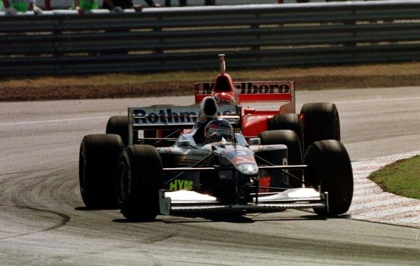 1997 Argentinian Grand Prix.Buenos Aires, Argentina.11-13 April 1997.Jacques Villeneuve (Williams FW19 Renault) leads Eddie Irvine (Ferrari F310B). They finished in 1st and 2nd positions respectively.World Copyright - LAT Photographic