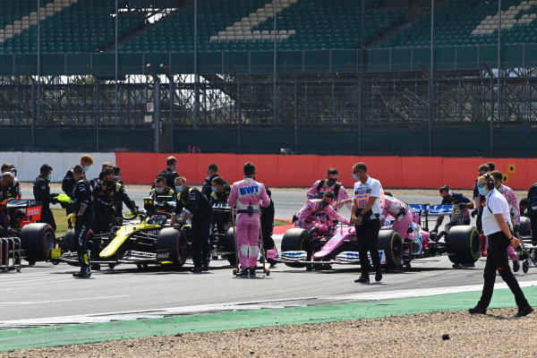 The cars of Daniel Ricciardo, Renault R.S.20, and Lance Stroll, Racing Point RP20, are brought to the grid