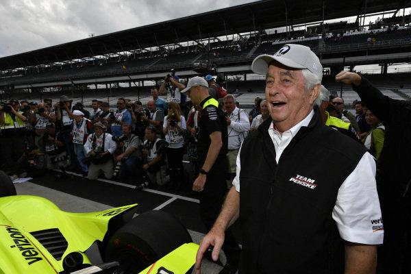 Roger Penske celebrates Simon Pagenaud, Team Penske Chevrolet winning the pole