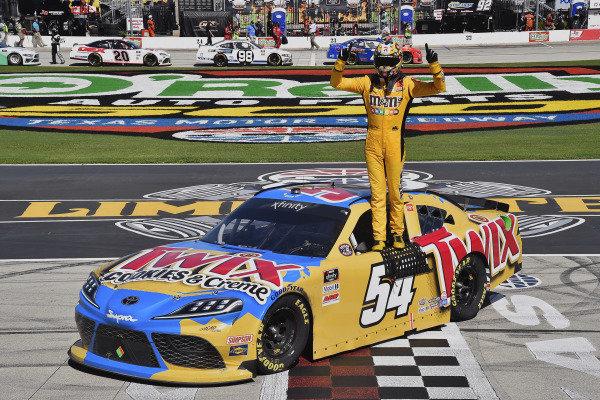 #54: Kyle Busch, Joe Gibbs Racing, Toyota Supra Twix Cookies & Creme celebrates his win