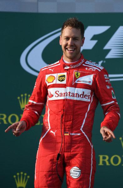 Race winner Sebastian Vettel (GER) Ferrari celebrates on the podium at Formula One World Championship, Rd1, Australian Grand Prix, Race, Albert Park, Melbourne, Australia, Sunday 26 March 2017.