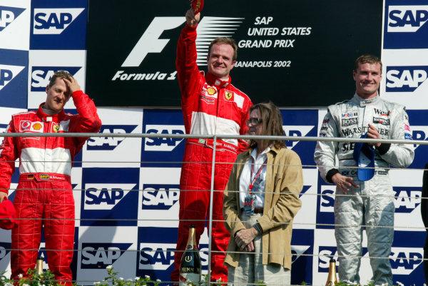 2002 American Grand Prix.Indianapolis, Indiana, USA. 27-29 September 2002.Michael Schumacher (Ferrari) 2nd position, Rubens Barrichello (Ferrari) 1st position and David Coulthard (McLaren Mercedes) 3rd position on the podium.World Copyright - LAT Photographicref: Digital File Only