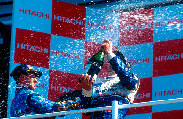1994 British Grand Prix.Silverstone, England.8-10 July 1994.Damon Hill (Williams Renault) 1st position gets showered by Michael Schumacher (Benetton Ford) 2nd position, but later disqualified for overtaking on the parade lap.Ref-94 GB 14.World Copyright - LAT Photographic