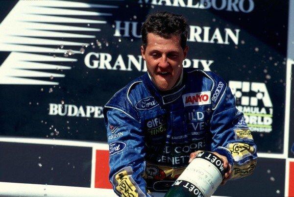 Michael Schumacher, 1st position, celebrates on the podium.