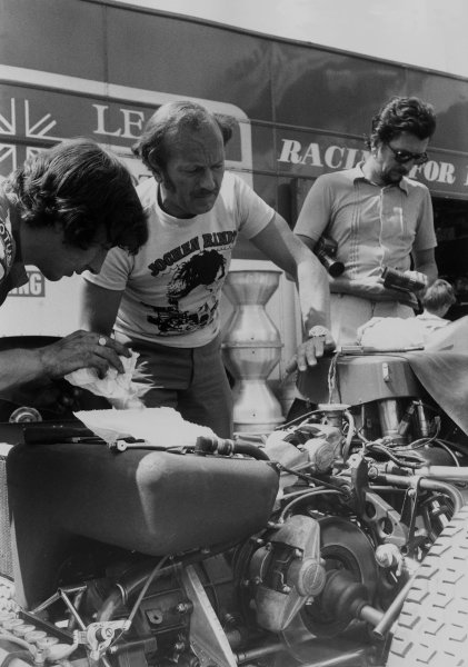Osterreichring, Austria. 14th - 16th August 1970.Colin Chapman looks over one of his Lotus 72C-Ford's in the paddock, portrait.World Copyright: LAT Photographic.Ref: Autocar Used Pic 27th August 1970 Pg 25.