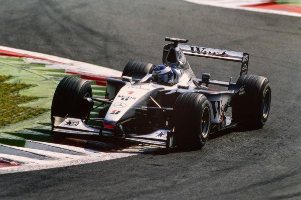 1999 Italian Grand Prix. Monza, Italy. 10th - 12th September 1999. Mika Hakkinen (McLaren MP4/14-Mercedes), retired action.  World Copyright: LAT Photographic.  Ref:  99ITA97
