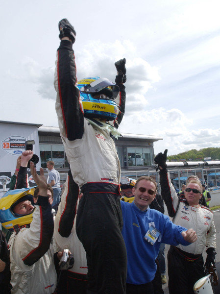 2003 ChampCar Series 3-5 May 2003 priorityLondon Trophy at Brands Hatch, EnglandSebastien Bourdais celebrates first ChampCar win with crew and father.2003- Dan R. Boyd USA LAT Photography
