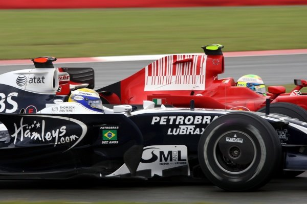 Felipe Massa (BRA) Ferrari F2008 passes Nico Rosberg (GER) Williams FW30. Formula One World Championship, Rd 9, British Grand Prix, Race, Silverstone, England, Sunday 6 July 2008.