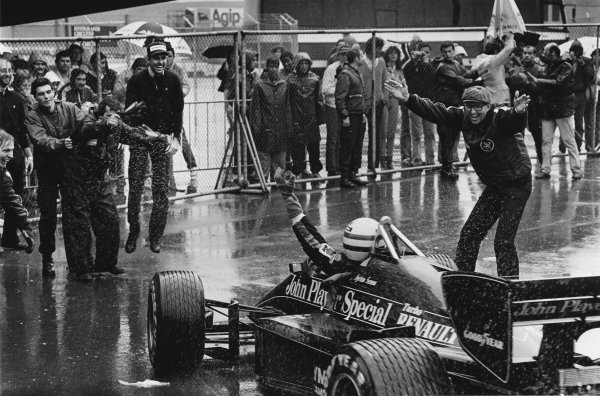 Estoril, Portugal. 19-21 April 1985. Ayrton Senna (Lotus 97T-Renault) celebrates 1st position with Team Manager Peter Warr (right) in parc ferme, portrait.  World Copyright: LAT Photographic. Ref: BATPOR7