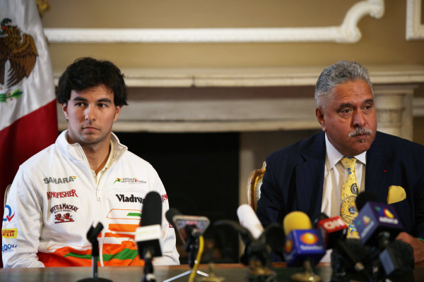 Force India F1 Driver Announcement Belgrave Square, London 12th December 2013 Sergio Perez and Vijay Mallya talk to the media. World Copyright: Sam Bloxham/LAT Photographic ref: Digital Image IMG_0946