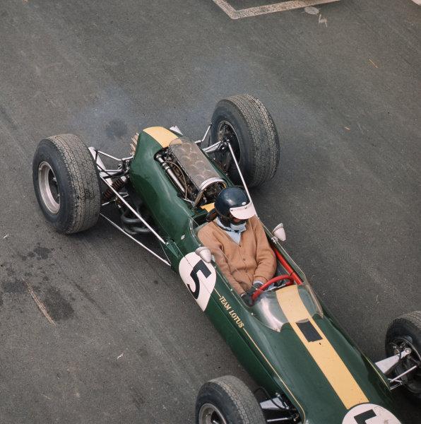 Watkins Glen, New York, USA. 1-3 October 1965. Jim Clark (Lotus 33 Climax) on the grid wearing a cardigan! Ref-3/1846. World Copyright - LAT Photographic