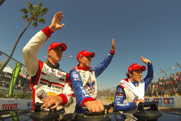 19-21 April, 2013, Long Beach, California, USA Graham Rahal, Takuma Sato and Justin Wilson wave to the crowd during the victory lap ©2013, Lesley Ann Miller LAT Photo USA