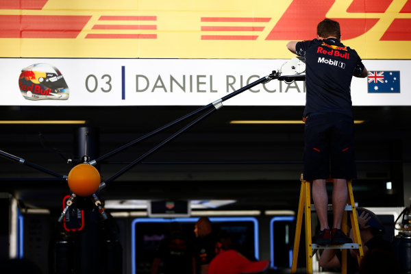 Sochi Autodrom, Sochi, Russia. Thursday 27 April 2017. A Red Bull team member adjusts signage over the pit garage for Daniel Ricciardo, Red Bull Racing. World Copyright: Andy Hone/LAT Images ref: Digital Image _ONZ8924