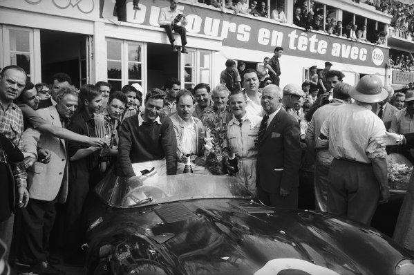 Le Mans, France. 22 - 23 June 1957.Ivor Bueb/Ron Flockhart (Ecurie Ecosse Jaguar D-type), 1st position, celebrate in the pits, portrait.World Copyright: LAT Photographic.Ref:  7440F - 27.