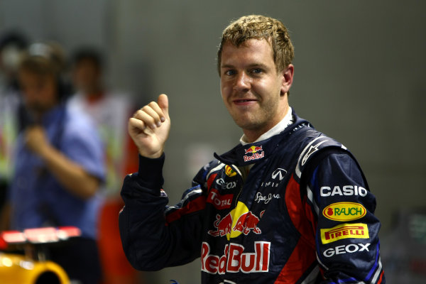 Marina Bay Circuit, Singapore.24th September 2011.Sebastian Vettel, Red Bull Racing RB7 Renault, celebrates pole. Portrait. World Copyright: Andy Hone/LAT Photographicref: Digital Image CSP28558