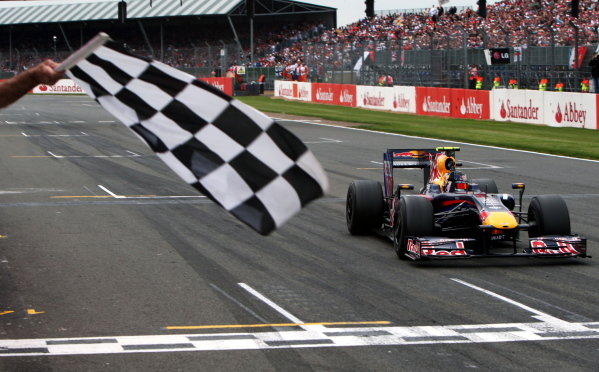 Race winner Sebastian Vettel (GER) Red Bull Racing RB5 takes the chequered flag. Formula One World Championship, Rd 8, British Grand Prix, Race, Silverstone, England, Sunday 21 June 2009. BEST IMAGE