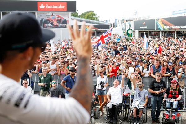 Hockenheimring, Hockenheim, Germany. Saturday 19 July 2014. Lewis Hamilton, Mercedes AMG, gives the crowd a wave. World Copyright: Charles Coates/LAT Photographic. ref: Digital Image _J5R4552