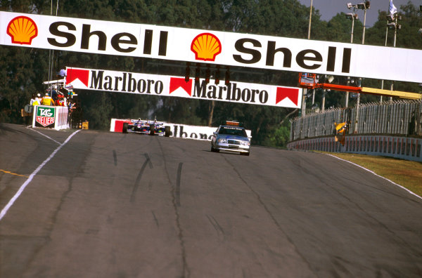 Buenos Aires, Argentina.11-13 APRIL 1997.The safety car leads the field while the track had to be cleared of debris form the accident involvoing Michael Schumacher and Rubens Barrichello.Ref-97 ARG 11.World Copyright - LAT Photographic