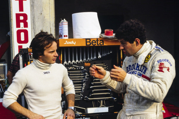 Gilles Villeneuve chats with Jody Scheckter.