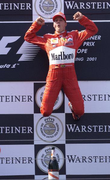 2001 European Grand Prix - Race.Nurburgring, Germany. 24th June 2001.Race winner Michael Schumacher, Ferrari F2001,in the air in triumph - podium.World Copyright: Steve Etherington/LAT Photographicref: 15mb Digital Image Only
