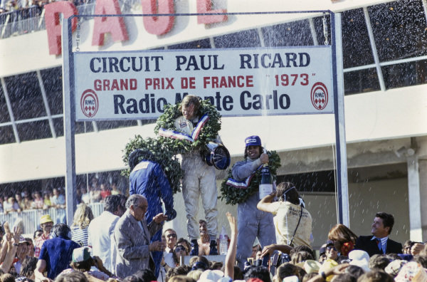 François Cevert celebrates 2nd position at his home race with winner Ronnie Peterson and Carlos Reutemann, 3rd position.