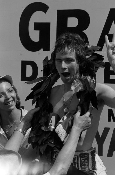 Barry Sheene pulls a face on the podium.
