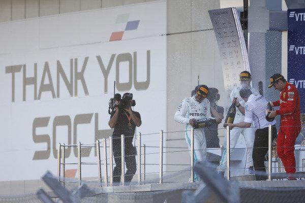 Race winner Lewis Hamilton, Mercedes AMG F1, Charles Leclerc, Ferrari SF90 and Valtteri Bottas, Mercedes AMG W10 spray champagne on the podium
