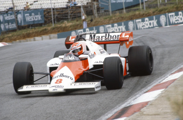 Niki Lauda, McLaren MP4-2 TAG, corrects a slide.