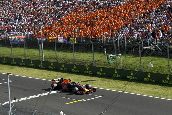 Max Verstappen, Red Bull Racing RB15 passes fans