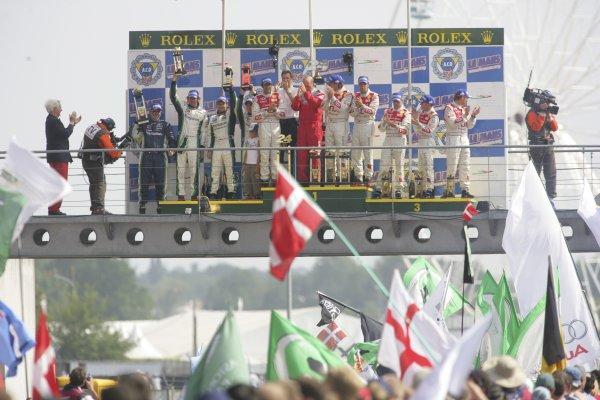 2006 Le Mans 24 Hours, Le Mans, France.14th - 18th June. LMPI Podium. F Biela (DEU)/ E Pirro (ITA)/ M Werner (DEU), Audi Sport Team Joest. and E Helary (FRA)/ S Loeb (FRA)/ F Montagny (FRA), Pescarolo Sport, Pescarolo Judd. and R Capello (ITA)/ T Kristensen (DNK)/ A McNish (GBR), Audi Sport Team Joest. Celebrate their win on the podium.World Copyright: Andrew Ferraro/LAT PhotographicRef: Digital Image Only ZP9O1503