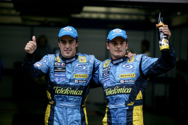 2006 Chinese Grand Prix - Saturday Qualifying Shanghai International Circuit, Shanghai, China. 28th September - 1st October 2006. Fernando Alonso, Renault R26, and Giancarlo Fisichella, Renault R26, celebrate their 1-2 in qualifying, portrait. World Copyright: Charles Coates/LAT Photographic. ref: Digital Image ZK5Y4474