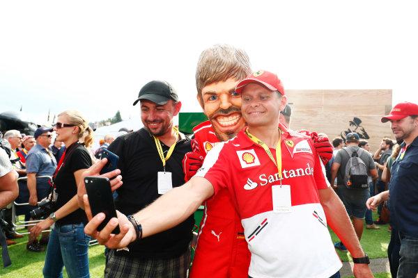 Spa Francorchamps, Belgium.  Saturday 26 August 2017. Fans take photos with a caricature of Sebastian Vettel, Ferrari. World Copyright: Sam Bloxham/LAT Images  ref: Digital Image _W6I0851