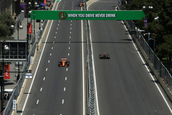 Baku City Circuit, Baku, Azerbaijan. Friday 23 June 2017. Fernando Alonso, McLaren MCL32 Honda, and Stoffel Vandoorne, McLaren MCL32 Honda, on opposite sections of the circuit. World Copyright: Charles Coates/LAT Images ref: Digital Image AX0W4896