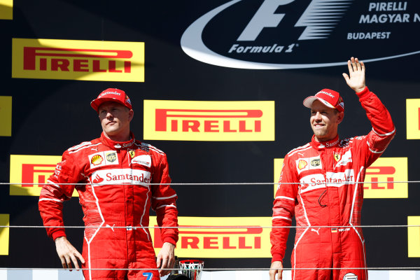 Hungaroring, Budapest, Hungary.  Sunday 30 July 2017. Kimi Raikkonen, Ferrari, 2nd Position, and Sebastian Vettel, Ferrari, 1st Position, on the podium. World Copyright: Glenn Dunbar/LAT Images  ref: Digital Image _X4I2846