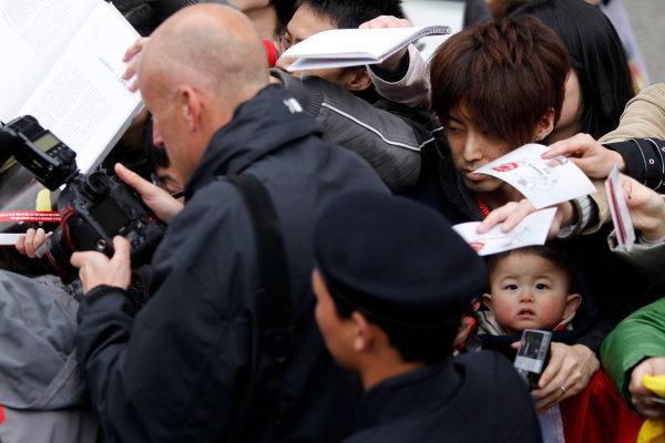 Shanghai International Circuit, Shanghai, China15th April 2010LAT Photographer Charles Coates in action. Portrait. Atmosphere. World Copyright: Andrew Ferraro/LAT Photographicref: Digital Image _Q0C5305