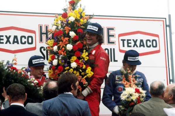 The podium (L to R): Niki Lauda (AUT) Ferrari, second; Gunnar Nilsson (SWE) Lotus, celebrating his first and only GP victory; Ronnie Peterson (SWE) Tyrrell, third. 