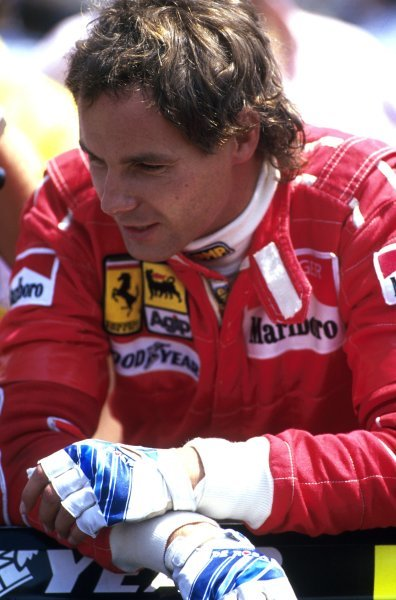 Gerhard Berger shows his burnt hands after his terrible crash at the San Marino GP