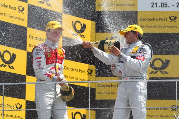 L-R: Race winner Mattias Ekstrom (SWE), Audi Sport Team Abt Sportsline, and Bruno Spengler (CDN), Mercedes-Benz Bank AMG, celebrate on the podium with champagne.