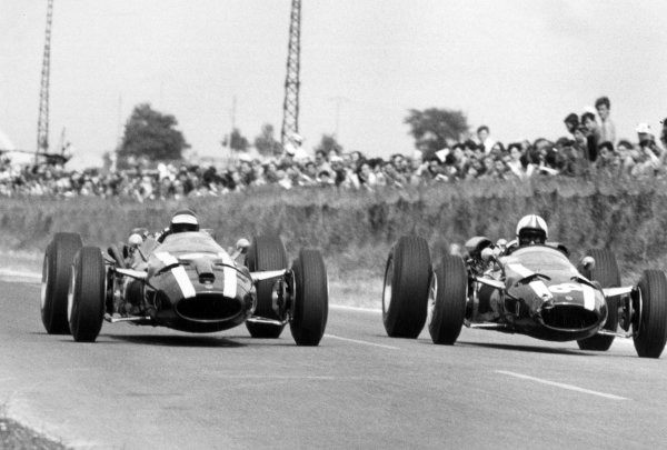 1966 French Grand Prix.Reims, France. 3 July 1966.Jochen Rindt, Cooper T81-Maserati, 4th position, left, and Chris Amon, Cooper T81-Maserati, 8th position, side-by-side, action.World Copyright: LAT Photographic