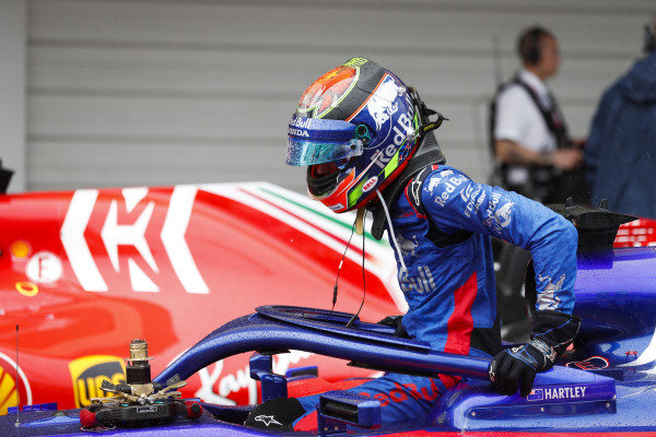 Brendon Hartley, Toro Rosso, exits his car in parc ferme.
