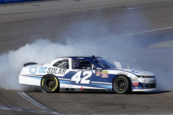#42: Ross Chastain, Chip Ganassi Racing, Chevrolet Camaro DC Solar celebrates his win with a burnout