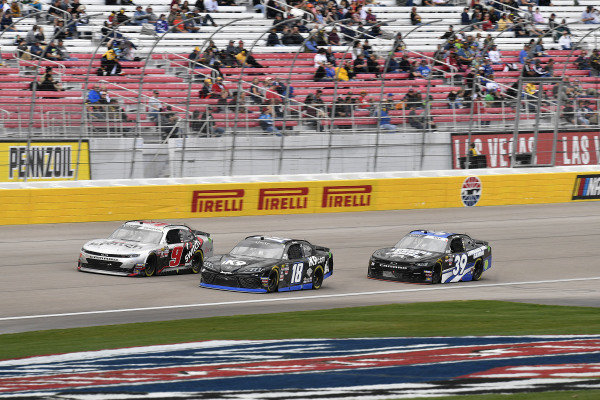 #18: Kyle Busch, Joe Gibbs Racing, Toyota Supra Extreme Concepts/iK9, #9: Noah Gragson, JR Motorsports, Chevrolet Camaro Switch and #39: Ryan Sieg, RSS Racing, Chevrolet Camaro CODE RUM