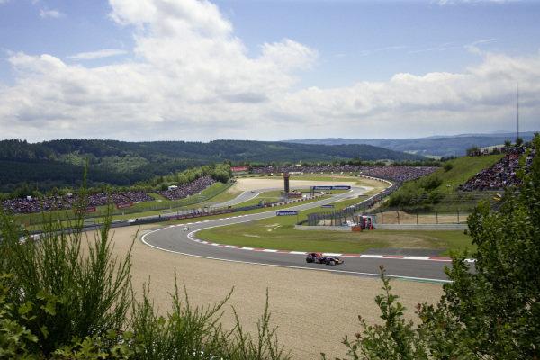 Mark Webber, Red Bull RB5 Renault leaves the Dunlop hairpin.