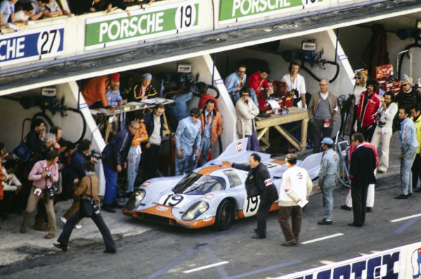 Richard Attwood / Herbert Müller, John Wyer Automotive Engineering, Porsche 917 K, prepares to leave the pits after a stop.