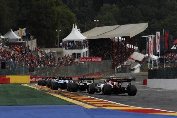 Robert Kubica, Williams FW42, leads Daniel Ricciardo, Renault R.S.19, and Kimi Raikkonen, Alfa Romeo Racing C38