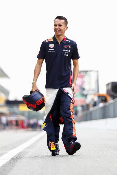 Alexander Albon, Red Bull Racing walks down the pit lane