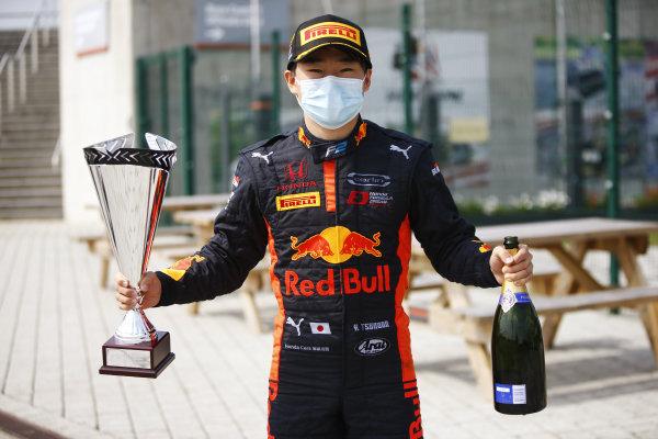 Yuki Tsunoda (JPN, CARLIN) poses with his winner's trophy and champagne